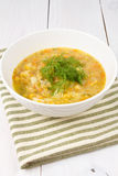 Yellow pea soup in bowl on white wooden background Stock Photography
