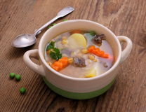Yellow pea soup, potato and stew meat Stock Photos