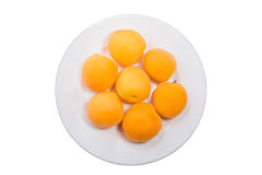 Yellow peach slices on plate isolated on white Stock Photography