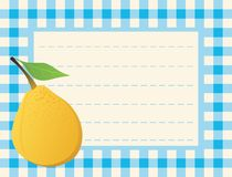 Yellow pear on chequered background Stock Photo