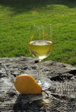 Yellow pear and glass of wine Stock Photo