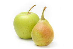 Yellow pear and green apple Stock Images