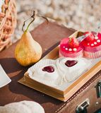 Yellow pear and heart-shaped cakes Royalty Free Stock Images