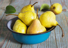 Yellow pear in a metal bowl Stock Photography