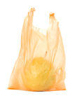 Yellow pear in orange plastic bag Royalty Free Stock Photos