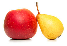 Yellow pear and ripe red apple Royalty Free Stock Images