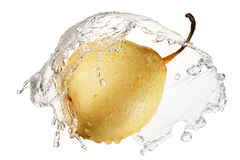 Yellow pear in splash of water Royalty Free Stock Images