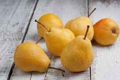 Yellow pears. On a wooden table Stock Photography