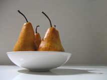 Yellow pears. Pears in a plate Stock Photography