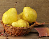 Yellow Pears In A Basket Royalty Free Stock Images