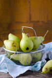 Yellow pears in a basket Royalty Free Stock Photography