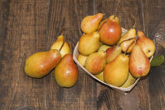 Yellow pears in a basket Stock Images