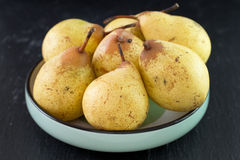 Yellow pears in bowl Royalty Free Stock Photography