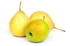 Yellow pears and green apple. Royalty Free Stock Photo