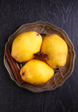 Yellow pears in a metal plate Royalty Free Stock Image