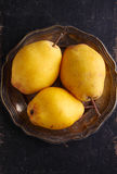 Yellow pears in a metal plate Royalty Free Stock Photos