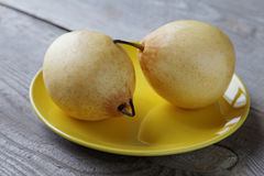 Yellow pears on the plate on a table Royalty Free Stock Photography