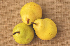 Yellow pears sitting on a table Stock Photography