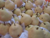 Yellow pears on white papers at bazaar in istanbul turkey. Fresh fruits at market place Stock Photography