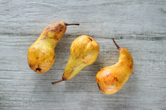 Yellow pears on white wooden background, top view. Royalty Free Stock Image