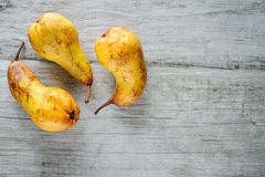Yellow pears on white wooden background, top view. Stock Photography
