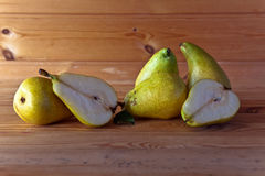 Yellow pears on wooden table Royalty Free Stock Photo