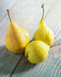 Yellow pears on an wooden table Royalty Free Stock Photography