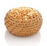Yellow peas in a wicker basket Stock Image