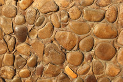 Yellow pebble stones on a wall  texture background Stock Image