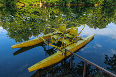 The yellow pedal boat abandonned Royalty Free Stock Photos
