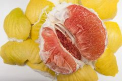 Yellow peeled pomelo cut in half. macro of insides stock photos