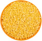 Peeled Split Mung bean. Yellow Peeled Split Mung bean, unpolished with cover Royalty Free Stock Images
