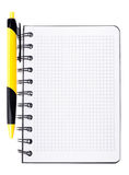 Yellow pen and notepad Royalty Free Stock Image