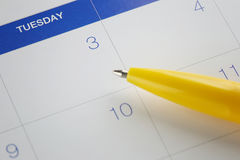 Yellow pen points to the number 3 on calendar background. Royalty Free Stock Photos