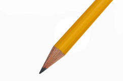 Yellow Pencil. A sharpened yellow number two pencil splits the frame diagonally against a clean white background Stock Photos