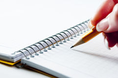 Yellow pencil on blank notebook Royalty Free Stock Photos