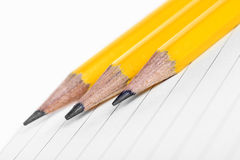 Yellow pencil on empty notepad Royalty Free Stock Photography