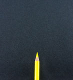 Yellow pencil lay on black craft paper background Royalty Free Stock Photo