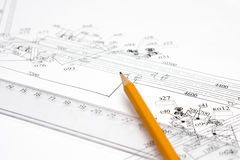 Yellow pencil on the line, and drawings on the tab. Pencil and a ruler is printed on the drawing Stock Image