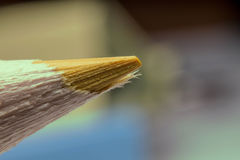 Yellow pencil. Macro yellow pencil on blur background Royalty Free Stock Photos