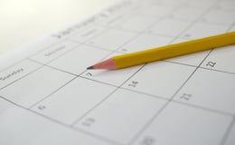 Yellow pencil on open calendar Royalty Free Stock Photos