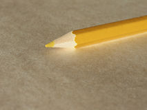 Yellow pencil over paper Royalty Free Stock Photos