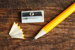 Yellow pencil with sharpener Royalty Free Stock Images