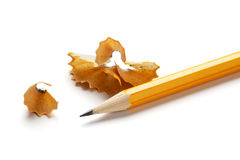 Yellow pencil and shavings isolated Royalty Free Stock Photos