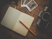 Yellow Pencil on White Book Near Camera Royalty Free Stock Photos