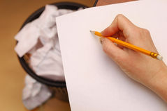 Yellow pencil  on a white paper. Hand holding yellow pencil  on  white paper Royalty Free Stock Photo