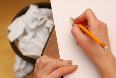 Yellow pencil  on a white paper. Hand holding yellow pencil  on  white paper Royalty Free Stock Images