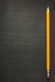 Yellow pencil on wood Stock Image