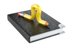 Yellow pencil worm in form caterpillar on a note book. Stock Photography