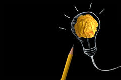 The yellow pencil with yellow crumpled paper ball and hand drawn. Yellow pencil with yellow crumpled paper ball and hand drawn a light bulb , creative innovation stock photos